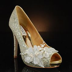My Glass Slipper High-There by Badgley Mischka in gold  adorned with hand-made, beaded decoration at the toe 4 1/2 inch heel with covered 3/4 inch platform at the peep toe