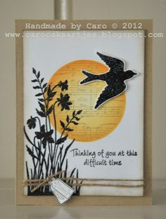silhouette wildflowers over a sponged sun with music score...like the bold contrast between black  and yellow/orange on this card...