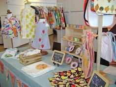Craft show inspiration: love the chalkboards, and pushing one rack back!