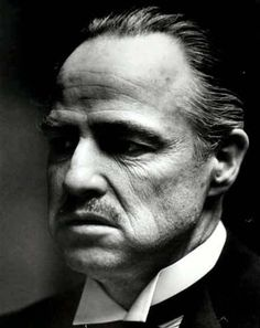 Marlin Brando, The Godfather . Makes you miss the dressing up .music, dancing . Close family. Most of all the old loyalty. ..