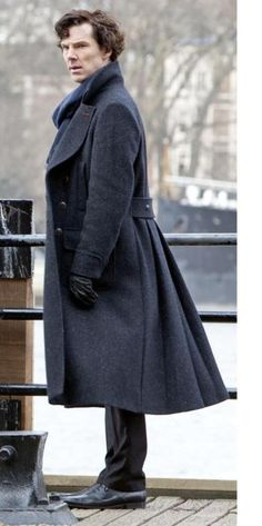 You need a long pea coat/trench coat. This is a decent length. Evidently, designers don't agree this year, but this is A) warm B) HOT C) smoking.  Hope Richard will show up in one.