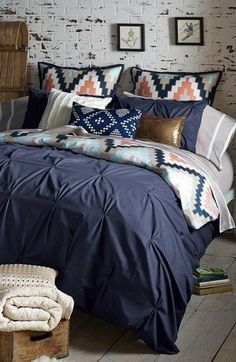 Love this great Aztec print in navy, gray, and coral! They compliment each other well in a bedding set