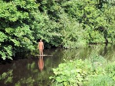 Anthony Gormley statue on the Water of Leith
