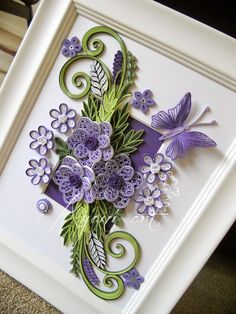 http://ayaniart.blogspot.in/2014/09/purple-and-green-quilling.html