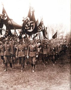 This picture is a parade of the Nazi third reich in France. I chose this picture because it was interesting and showed what was happening with the military in the 1920's. The people in this picture are Nazi soldiers, leaders and supporters.