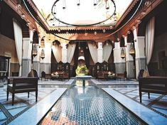 Etro coat.  The rose-red city of trading. A riad -- a Moroccan party house/playpen-- Riad Lotus Privilege. Shops in the ...
