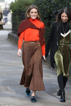 A dream in tangerine:The socialite, 30, rocked a bright orange turtle neck jumper with a sparkling dark brown skirt at the Pringle of Scotland showcase at One Marylebone