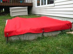 diy sandbox cover- outdoor fabric/canvas, grommets & bungees