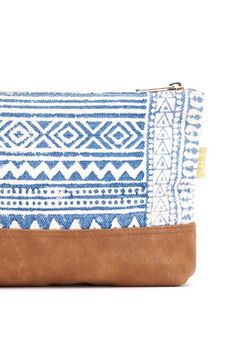 Featuring a tribal-inspired design, this clutch will add flair to any outfit.