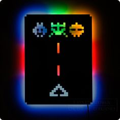 Illuminated Space Invaders Wall Light - Blue, Red, Green - Gamer Geek Decor. $85.00, via Etsy.