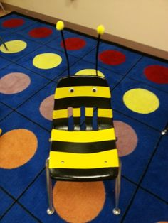 Bee Chair. Yellow chair,  painters tape, black spray paint,  2 googly eyes,  2 black pipe cleaners,  2 yellow pom pons, hot glue. Fun chair for Read to Self Time in my bee themed classroom!