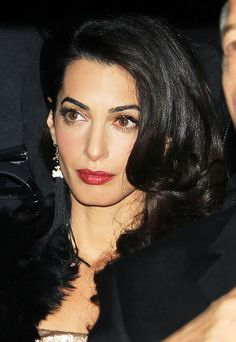 Amal Clooney (Human rights lawyer, wife of George, fashionista, and Anne Hathaway look-alike in this photo!)
