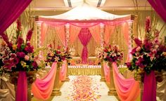 Indian wedding decor with fabric on aisle also looks really pretty.