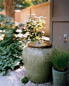Greet guests with the tranquil sound of falling water in a pump-fitted urn with a motor that moves the water underground.