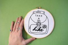 Take a hike! NO SERIOUSLY. Go take a hike! Hand Embroidered using DMC floss, fabric remnants, and a wooden embroidery hoop. The back is