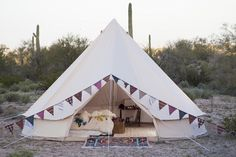 Bell Tent by Stout Tent: 16.5 feet in diameter, 9.5 feet tall in the center. 100% cotton canvas (9.5 oz) with a zippable heavy duty groundsheet. Roll-up the sides of the tent to catch a breeze on a warm day. Waterproof, mold resistant. $950