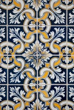 Spanish tiles... bc of the Navy in these tiles, fiery reds & rich greens are your accent colors