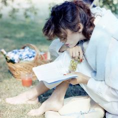by Tom Palumbo  reading on an outdoor picnic