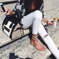 White Ripped Skinny Jeans With A Black Tank Top That Has A Kimono Over It And Sandles