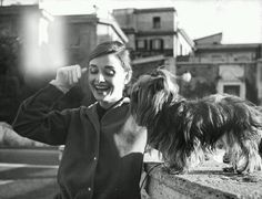 Audrey Hepburn and Mr. Famous photographed on the Spanish Steps in Italy, 1958
