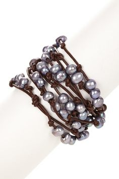I've been wanting to make something like this but need to find pearl beads with larger holes...
