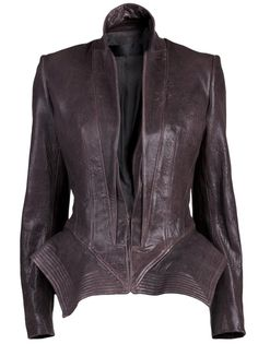 Exclusive jacket in anthracite from Haider Ackermann. This leather fitted jacket features reversed notch lapels, a concealed front hook and eye closure, front seam detail going down the garment, and an angular accentuated peplum waist. Has long sleeves, back side vents, and folded seam detail at the hemline.