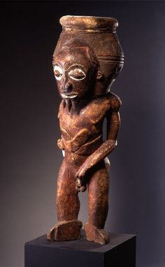 Africa | Drum from the BaTeke people of Congo | Wood, nails, leather and pigment | 19th century