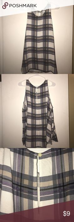 Old Navy Plaid Tank Top Grey, purple, & taupe plaid tank top from Old Navy. Neck line is high, like a t-shirt. Has a keyhole feature in the back. This tank has been worn less than 5 times. It's in excellent condition, no pulling, no snags. Old Navy Tops Tank Tops