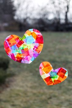 Love these colorful Rainbow Heart Suncatchers to brighten up dreary winter windows! Perfect for Valentine's Day!