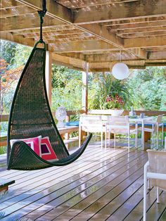 swing chair Jonathan Adler / coastal living magazine