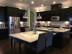 I like the dark cabinets and how they are finished at the ceiling.