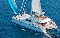 A catamaran with sails #theyachtowner #theyachtownernet