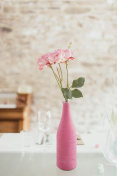 yarn wrapped vases ad a pop of colour to this white wedding // photo by @Jonas Peterson