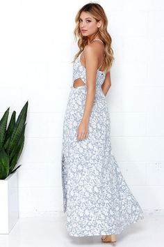 You'll feel as if you've been transported to Paradise Beach when you slip on the Billabong Sounds of the Sea Blue and Ivory Print Maxi Dress! Washed blue floral print decorates lightweight, woven fabric forming a halter neckline, sleeveless bodice with elasticized waistline, plus drawstring ties and sexy side cutouts. A billowing maxi skirt wraps around to reveal two sultry, thigh-high slits at front. Adjustable spaghetti straps crisscross at back. Metal logo tag at back. Unlined. Dress…