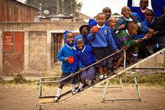 Little ones slipping and sliding at the Mwangaza Tumaini School in Nairobi, Kenya. Photo by Morgana Wingard