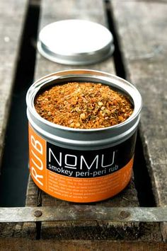 NoMu- Tracy Foulkes is the heart and soul behind NoMU. Her passion for flavour inspired her to start the company in December 2000 in a very small, front room of her home in central Cape Town. Her love of spices and the stylish, uncomplicated way she loves to cook is very much evident in the NoMU range of products.  Here at The Hospitaity Establishment we stock a range of rubs from the NoMu range. Cape Town, Coffee Cans, Spices, December, Retail, Range, Passion, Inspired, Stylish