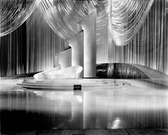 This magnificent set was designed for Broadway Melody of 1940. It was the largest musical set yet made by MGM. The effects of shimmering light is heightened by the polished floor and the silver streamers suspended from above, all reflecting the black and white set.
