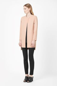 Made from lightly textured crepe, this long blazer is a clean, minimal style. A subtle A-line shape with long sleeves, it has a graduated hemline, silky lining and an easy open front. Wear it as a blazer or a lightweight jacket.