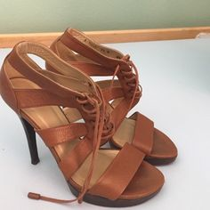 Beautiful Stuart Weitzman sandals Beautiful brown Stuart Weitzman sandals, true to size at 8 1/2. Four inch heels, just too high for me. Soles reflect wear, see photo, but uppers show very little wear. Purchased on posh, only looking to pass them on. Stuart Weitzman Shoes Sandals