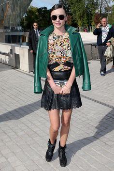 Miranda Kerr wears a Louis Vuitton top, skirt, jacket and boots.
