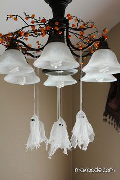 Hanging-Ghosts.........http://www.makoodle.com/hanging-ghosts-halloween-decor/#