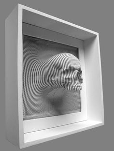 So, I saw a skull for fish tanks at walmart over the weekend. I think if I cut the back  of the skull off, attached it to the wall and then put a frame around it, would be kind of cool. Something like this.