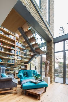 Double height crittall style glazed extension in London with a single spine bespoke staircase. www.hollandgreen.co.uk