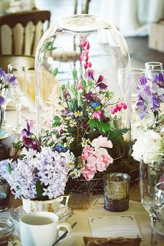 Enzoani for a Whimsical Wedding in the North West. Floral centre piece. Image by Stella Photography. Read more: http://bridesupnorth.com/2016/01/19/secret-garden-enzoani-for-a-wonderfully-whimsical-wedding-in-the-north-west-natalie-jamie/