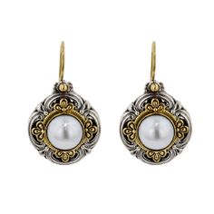"""Konstantino uses Gifts of Nature in his designs… Mother of Pearl with raised cut stone possesses a mysterious and beckoning iridescence — light reflected from the ethereal heavens above. It reminds the wearer to """"Have faith""""."""