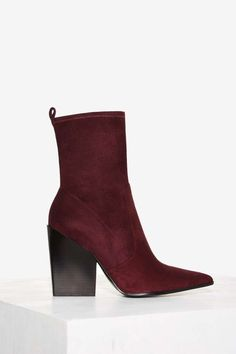 Kendall + Kylie Felicia Vegan Suede Boot. Guilty pleasures done right—the Kendall + Kylie collection just arrived. The Felicia Boot is made in burgundy vegan suede and features a pointed toe, block heel, inside zip closure, and cushioned insole. (affiliate)