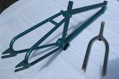 """Mid 80's Excaliber expert racer. 100% Titanium frame and forks.  Extremely rare and in beautiful shape! Top tube measures 18.5"""" from center to center.   Excaliber was a small custom BMX frame manufacture based in Corpus Christi, TX run by the Osborn family. They were in business from 1985-86. PM me if you have any additional information on this particular F/F or Excaliber in general."""
