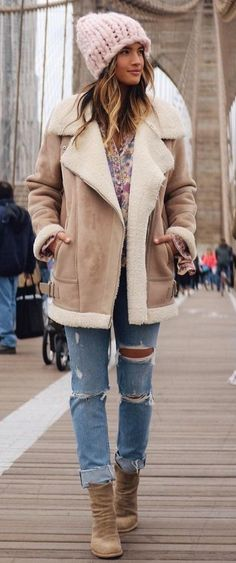 what to wear with boufriend jeans : knit hat + nude jacket + boots + printed blouse