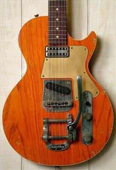 """Fano Alt de Facto SP6 Relic Guitar in distressed Roundup Orange finish, featuring a swamp ash body with a contour and style that can only be described as a """"mash-up"""" between a Les Paul Junior and a Telecaster. The neck is Maple combined with a Madagascar fretboard, Fralin custom-wound TV Jones 'Tron neck pup and T-style bridge pickup, and Bigsby vibrato."""