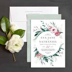Wild wreath wedding invitations with beautiful florals and greenery.